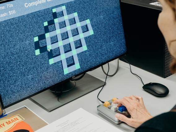 Woman testing a student created game